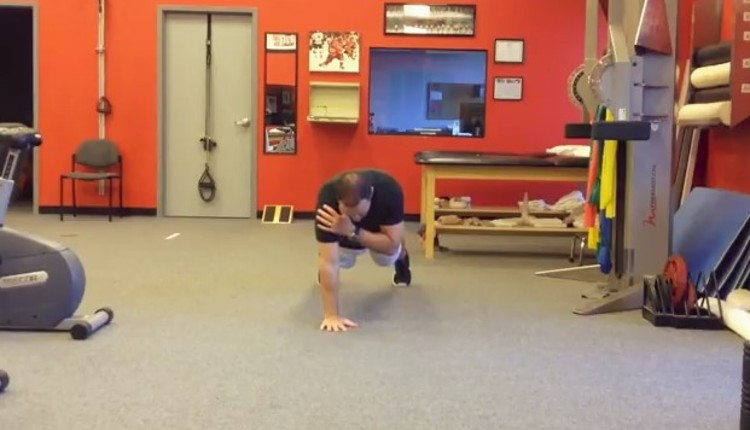 Tall plank shoulder taps